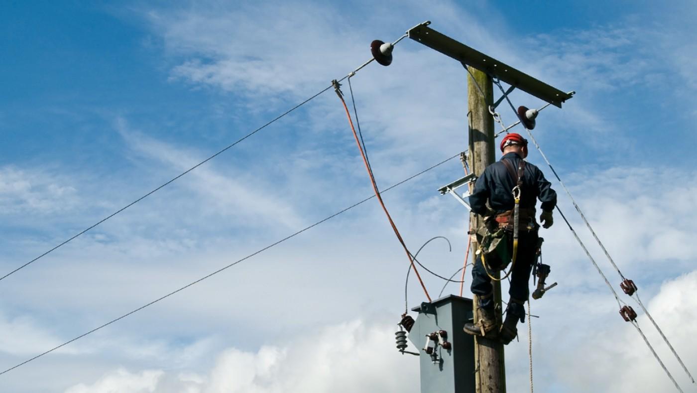 Electrician repairing lines