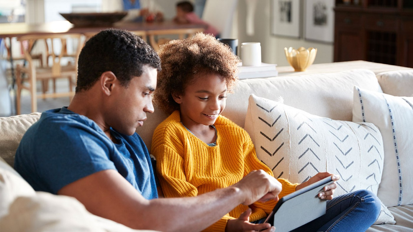 father and son looking at an ipad