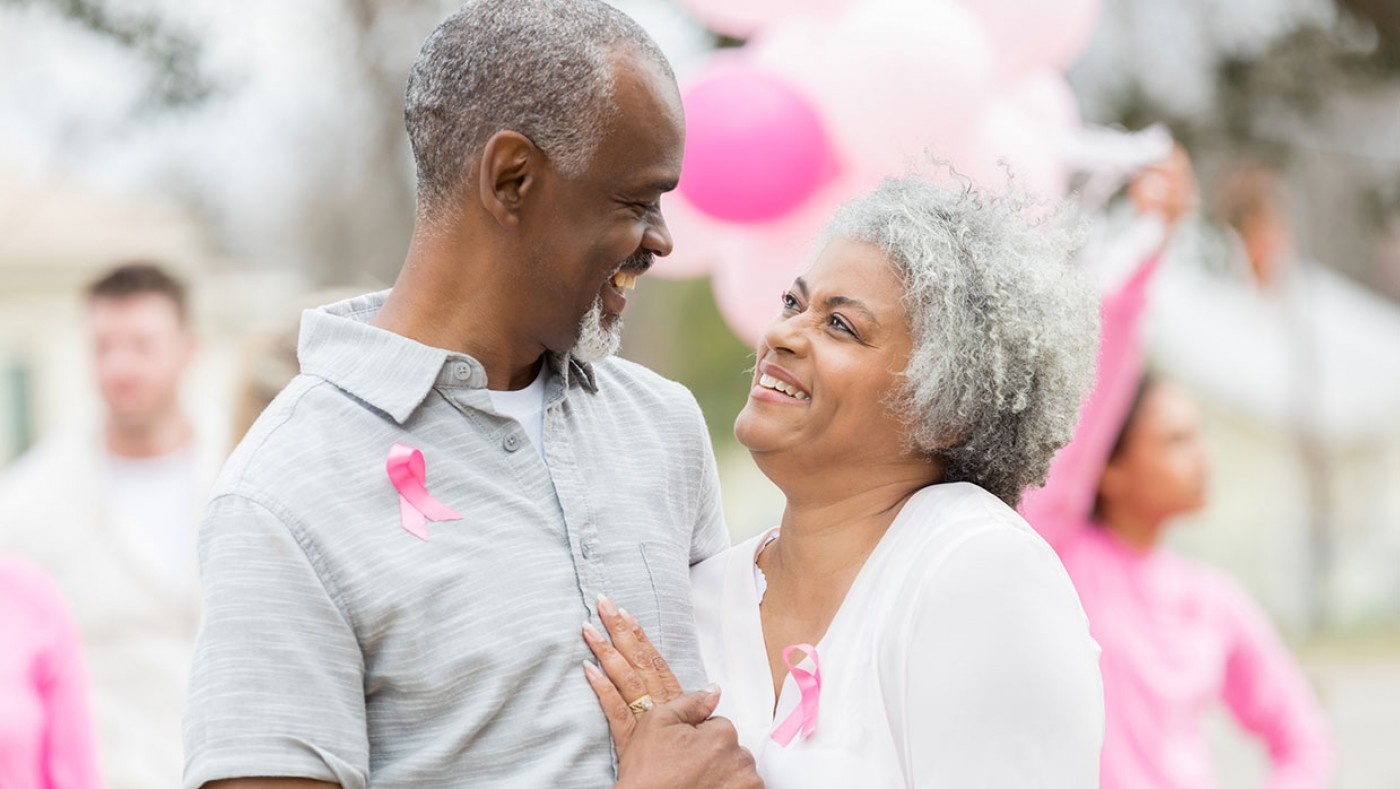 older couple supporting breast cancer awareness