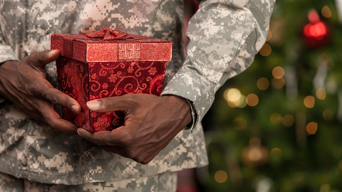 soldier holding a Christmas gift