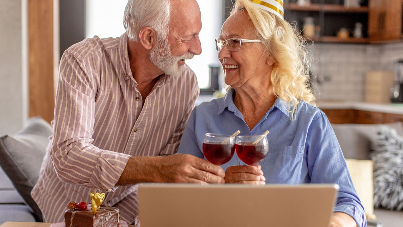 older couple celebrating with a virtual party